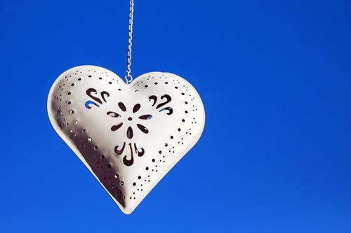 Heart-shaped White Hanging Decor With Blue Background
