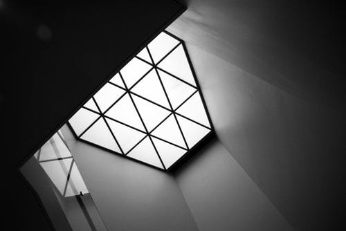 Grayscale Photo of Glass Panel Window