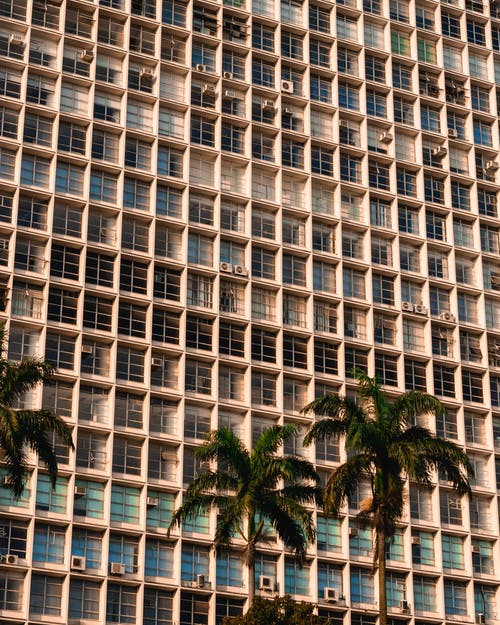Photo of Building Near Palm Trees