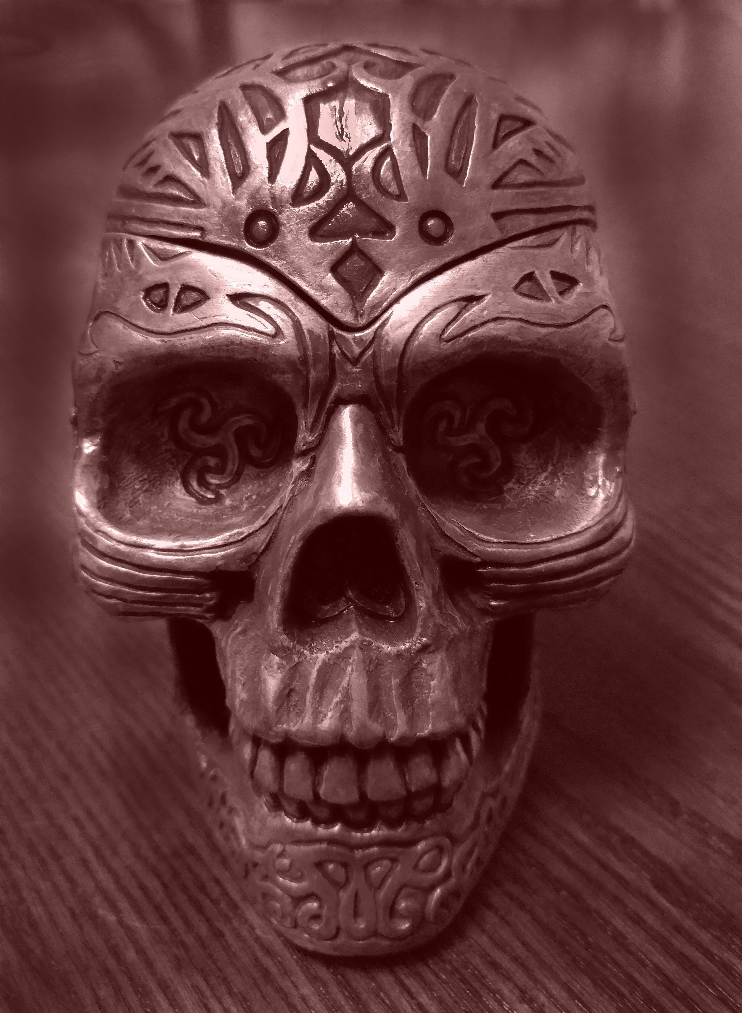 Gray Metal Skull on Brown Wooden Surface