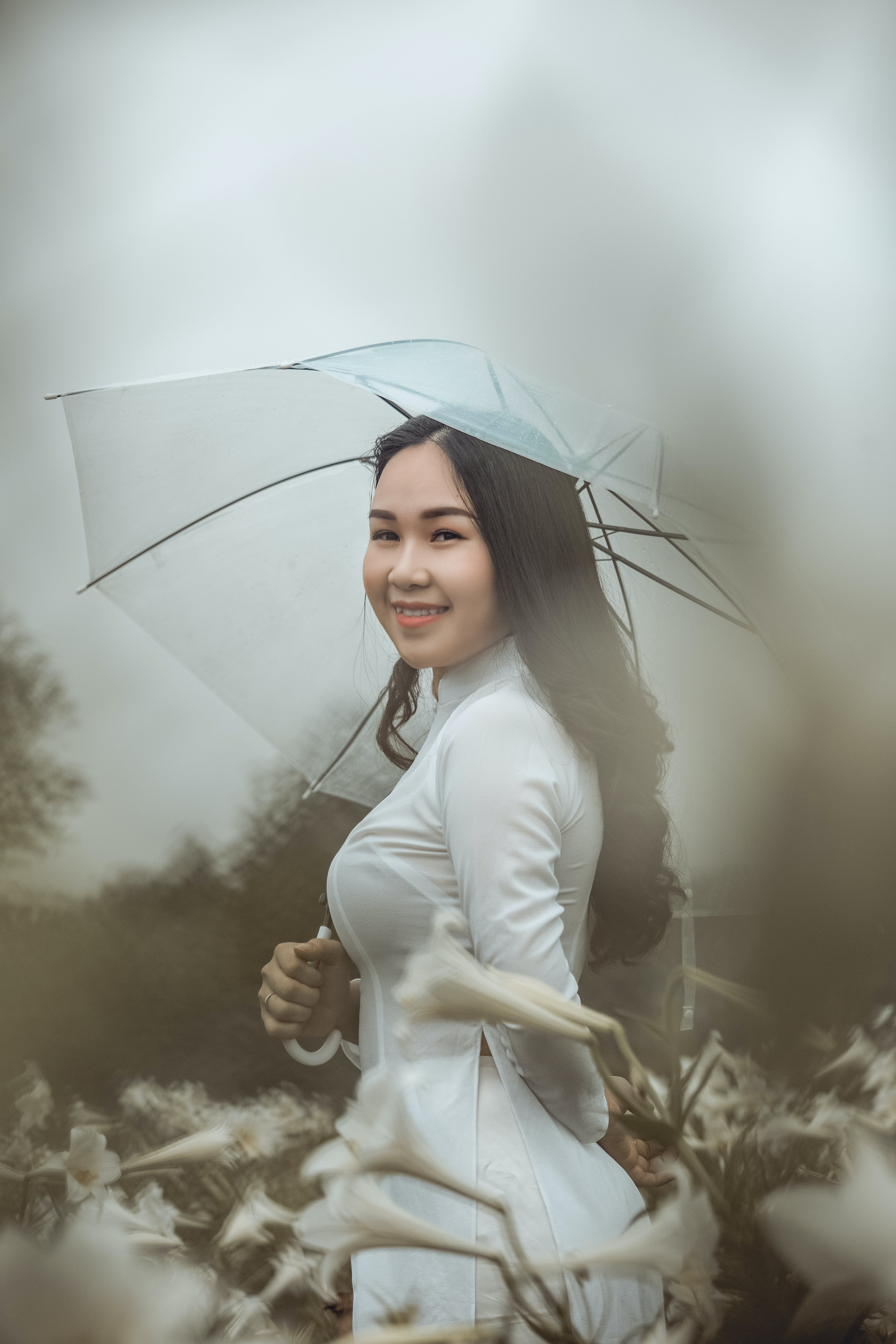 Smiling Woman Wearing White Long-sleeved Dress Holding White Umbrella