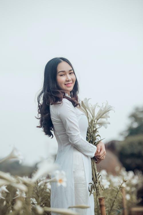 Gratis lagerfoto af ao dai, asiatisk kvinde, Asiatisk pige, bane