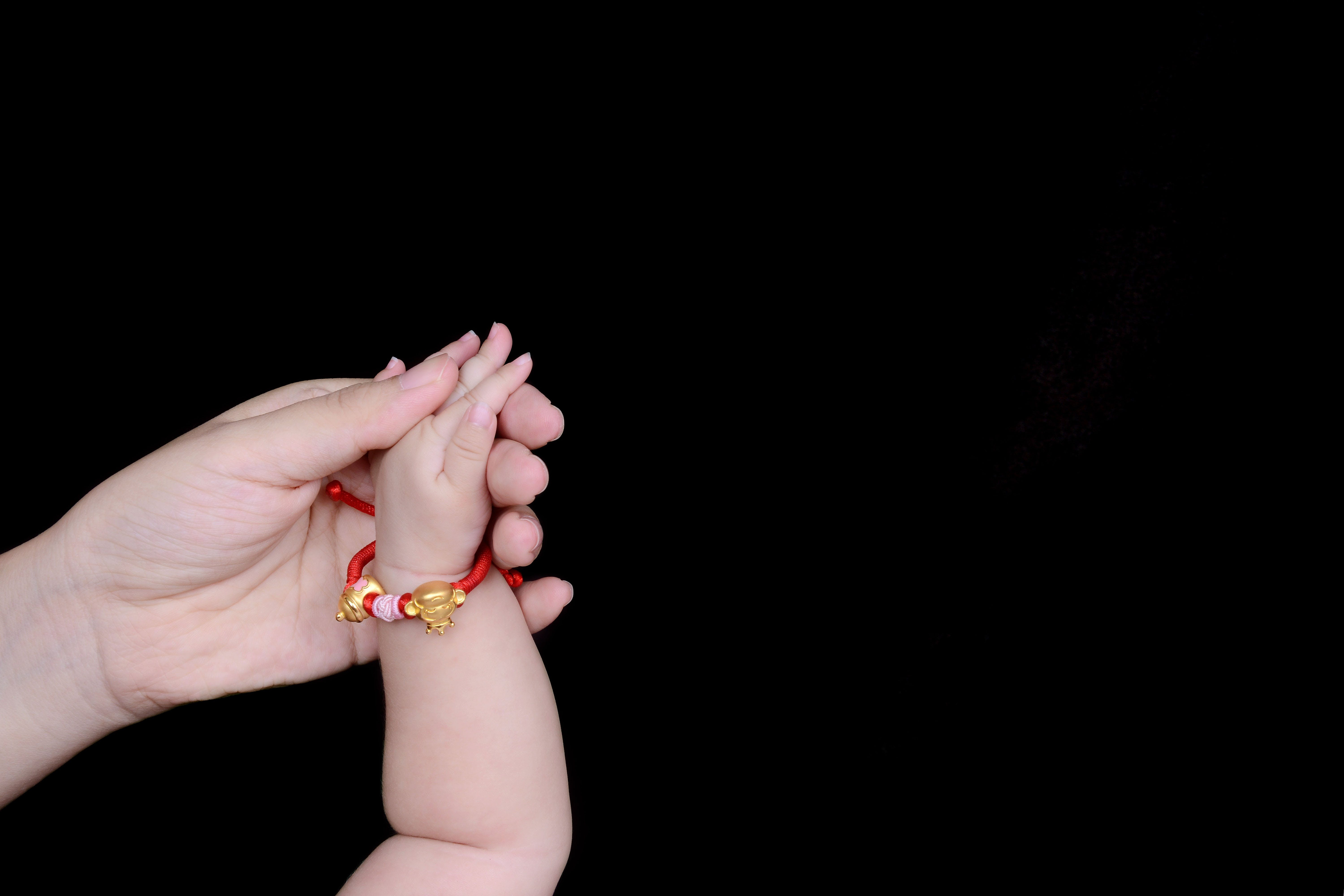 Person Holding Baby's Hand