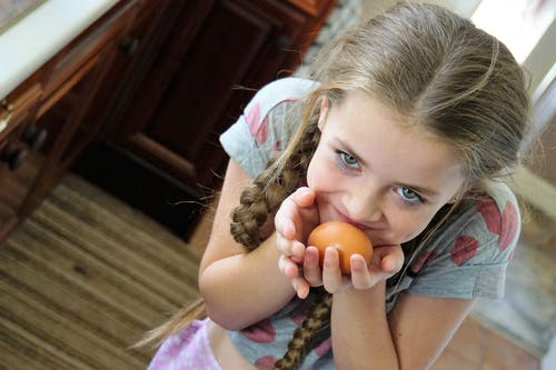 Girl Holding Egg