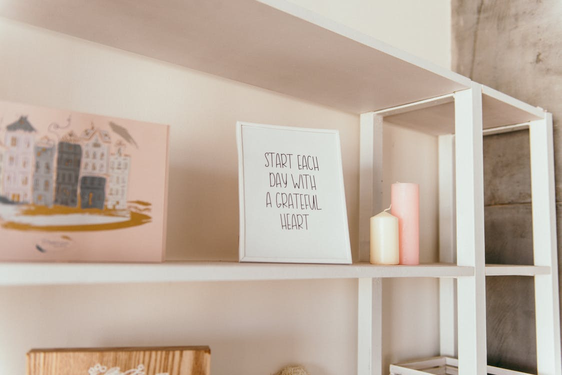 Quote Sign Standing on Wooden Shelf