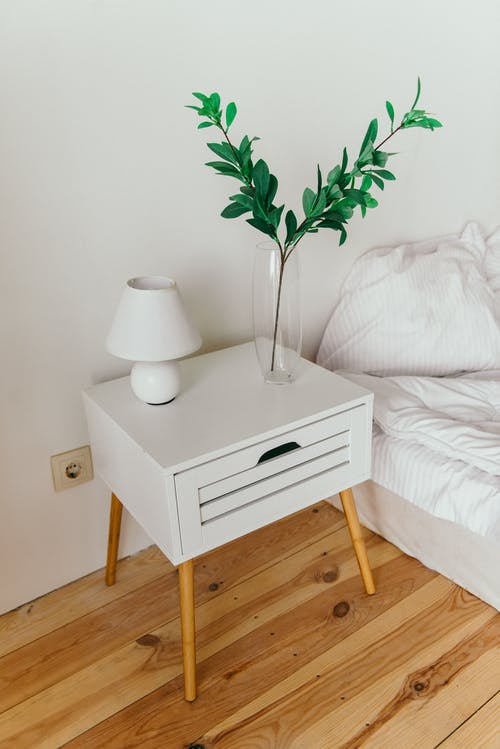 White Table Lamp on Top of Nightstand