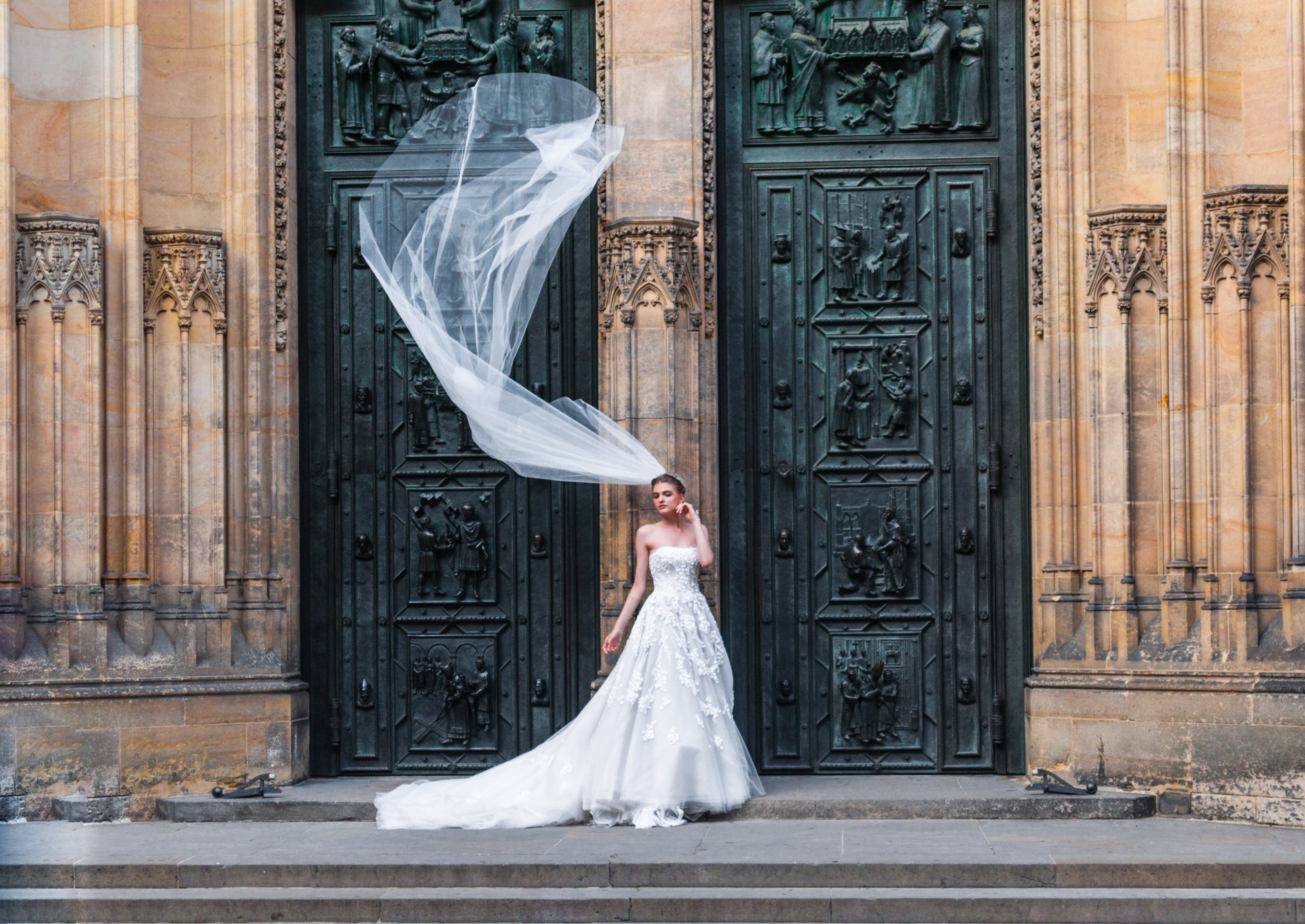 Woman Wearing Wedding Dress Standing Near Closed Doors