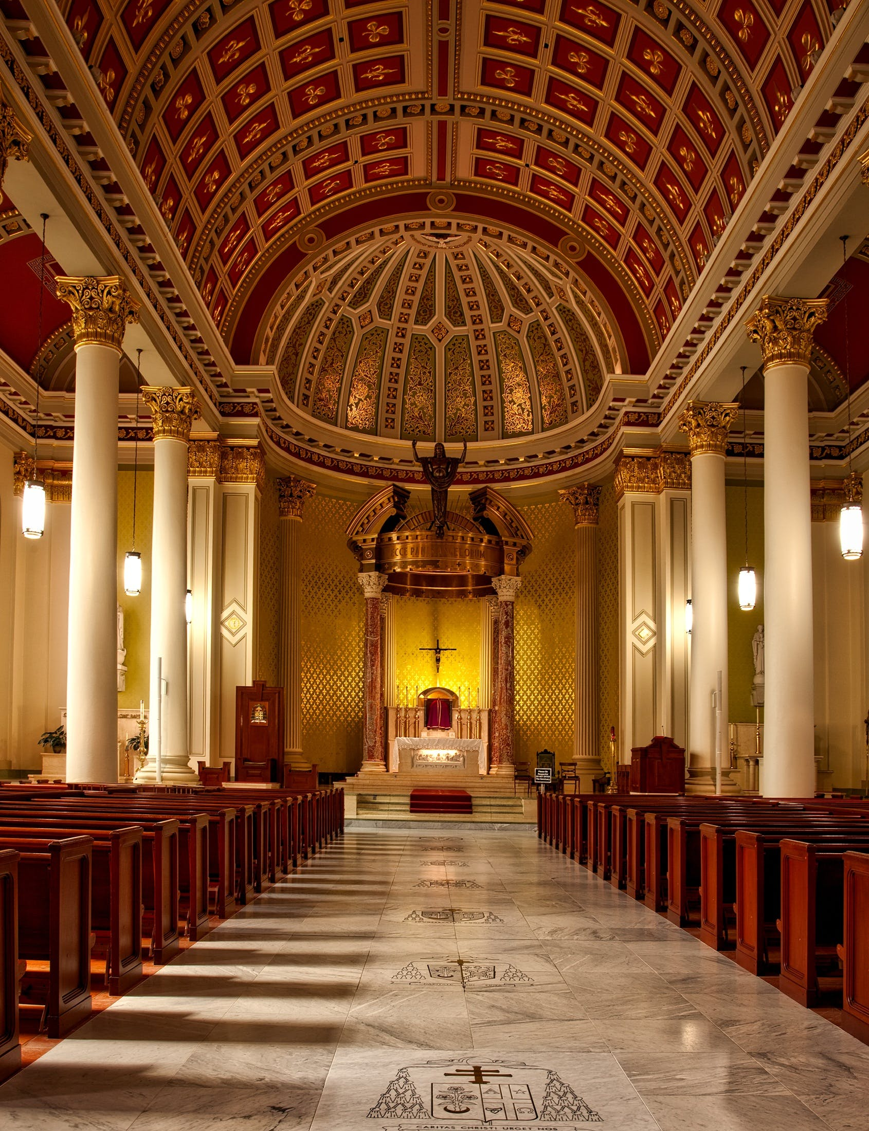 Empty Cathedral Seats and Hallway With Lights Turned on