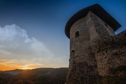 Безкоштовне стокове фото на тему «архітектура, гора, Захід сонця, краєвид»