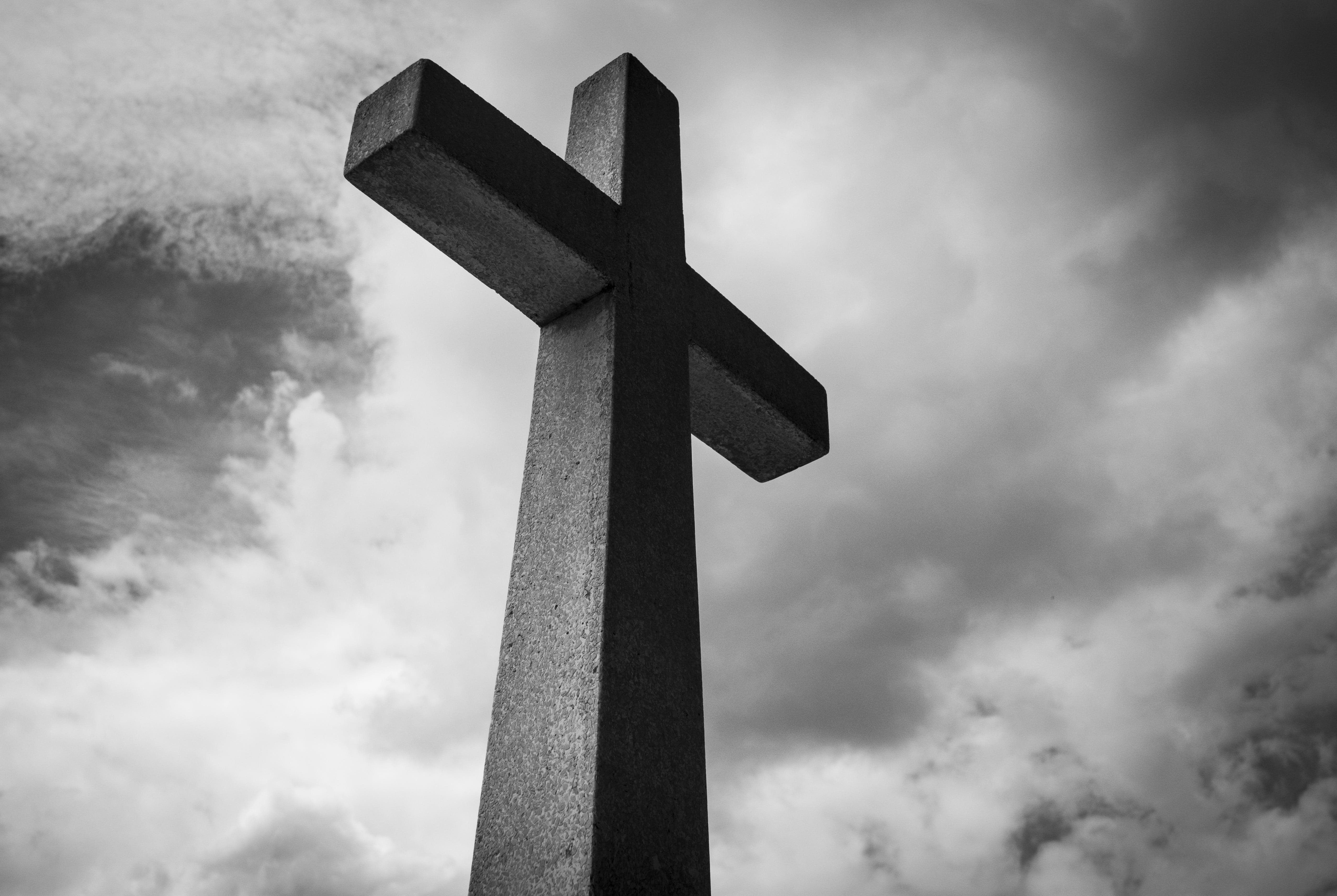 Low Angle Photo of Concrete Cross Under Clouds