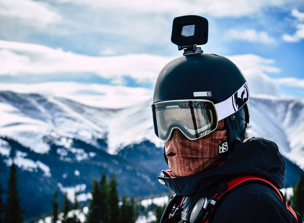Man in Goggles and Helmet With Action Camera