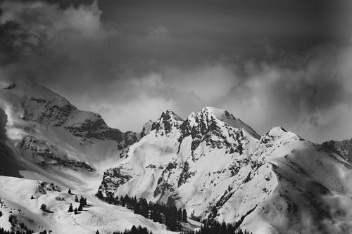 Grayscale Photo of Snow Capped Mountain