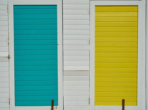 Closed Blue and Yellow Wooden Doors