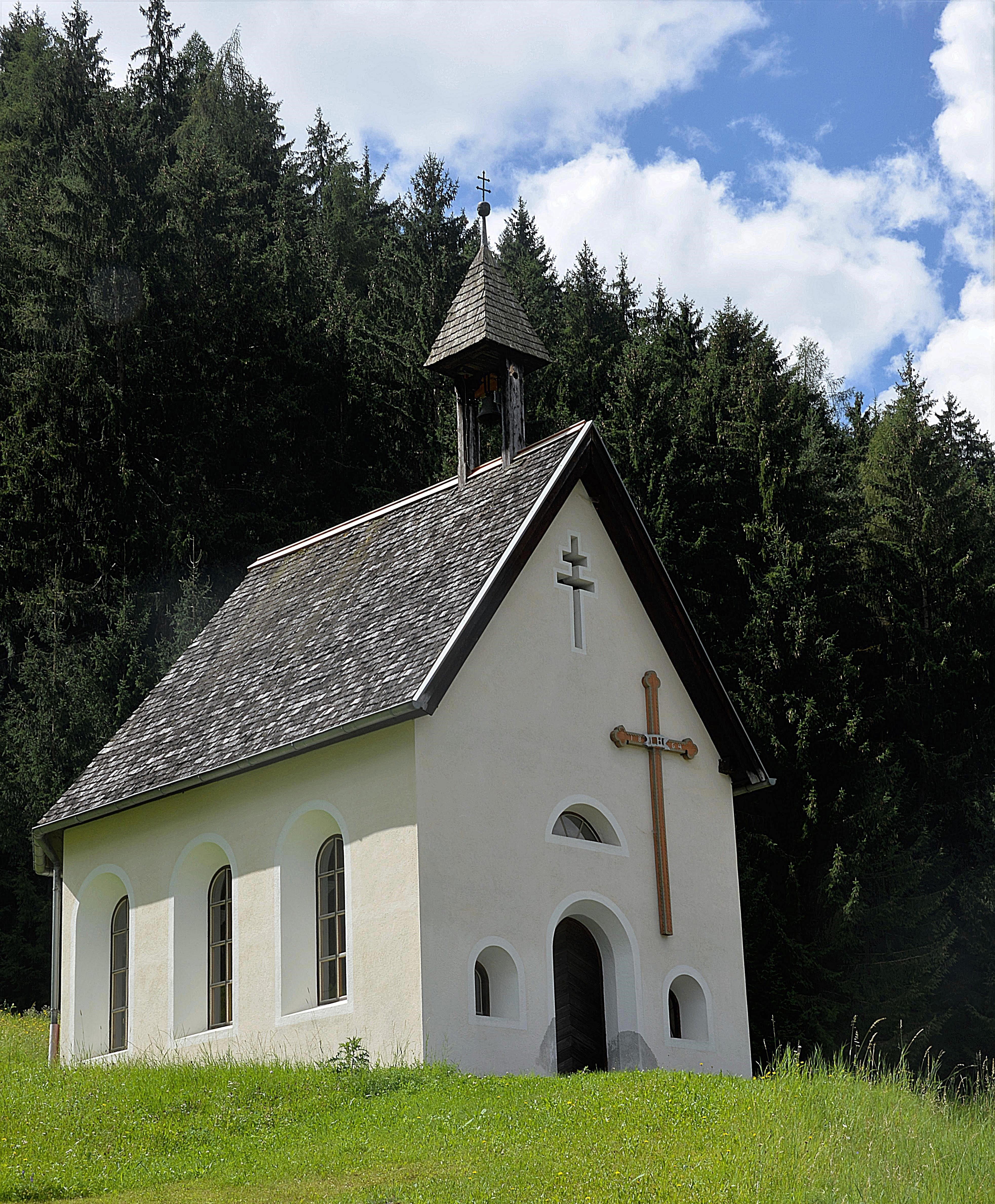 White And Grey Church Near Trees Under Clear Blue Sky