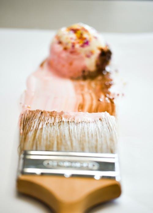 Paintbrush Near Scoop of Icecream