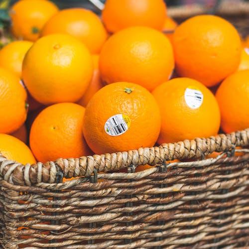 Oranges in Brown Wicker Basket
