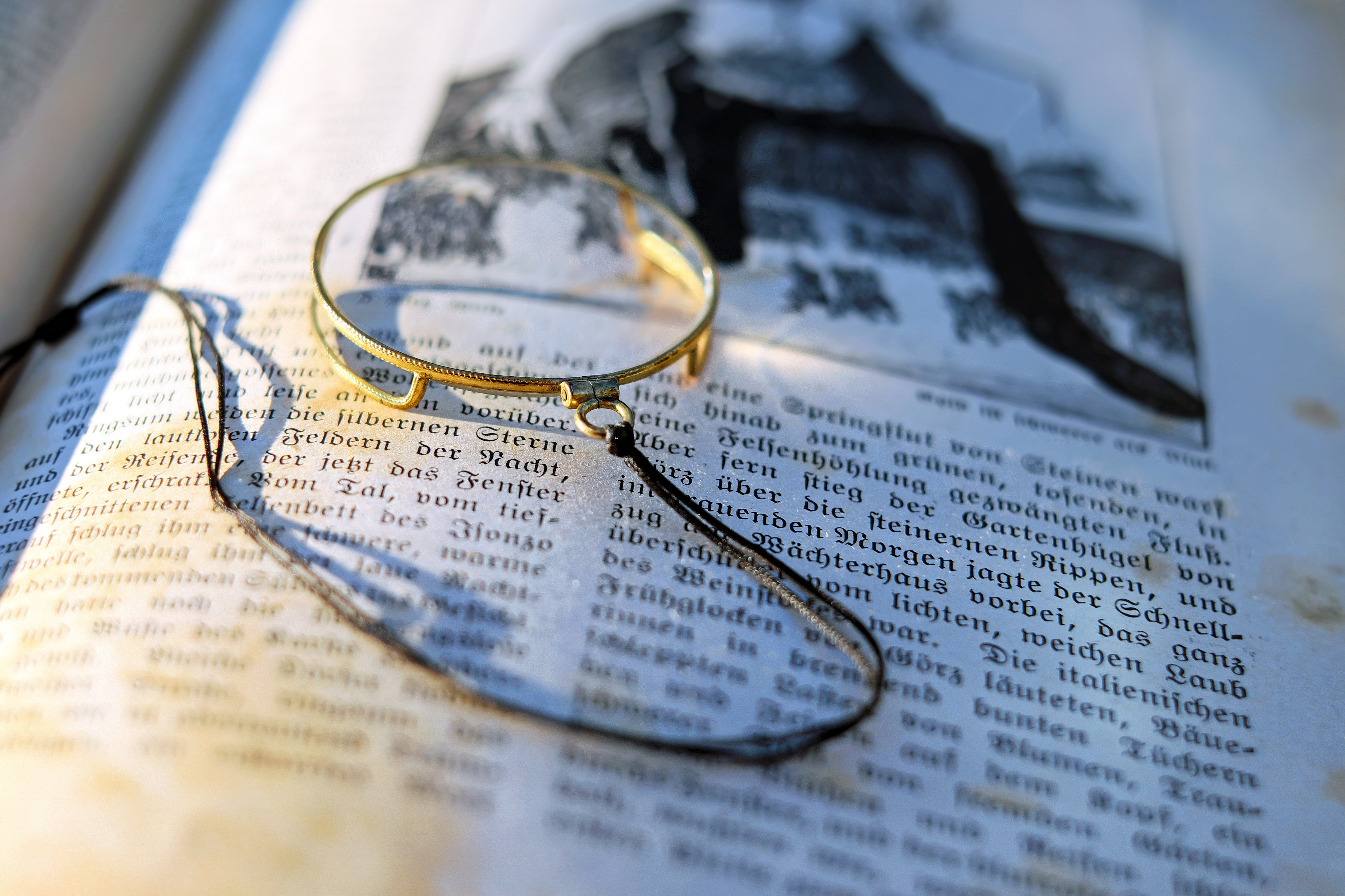 Magnifying Glass Over Book