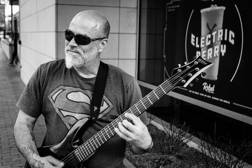 Monochrome Photo of Man Playing Electric Guitar
