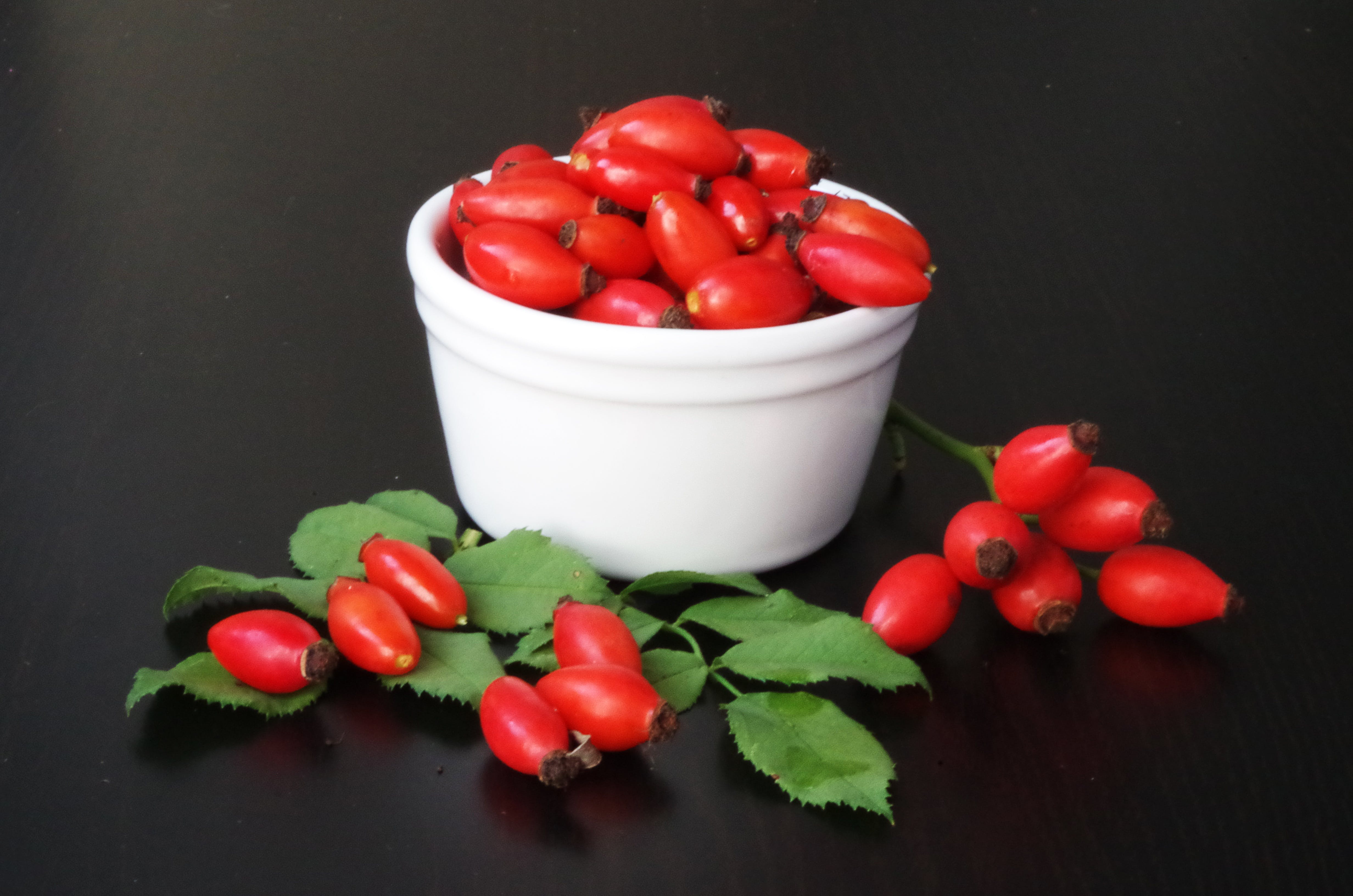 Red Fruits on White Container
