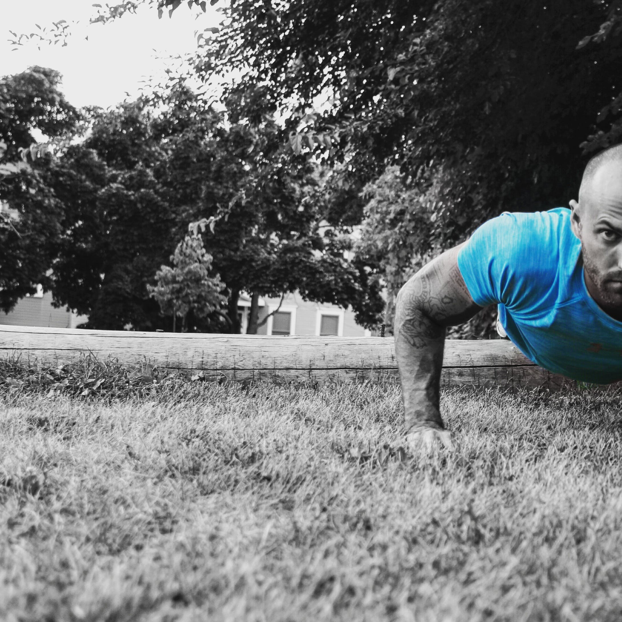 Selective Color Photography of Man Push-uping