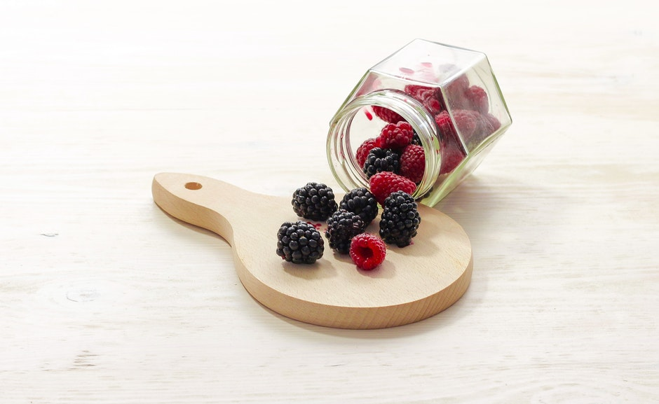 Clear Glass Bottle With Raspberries Inside