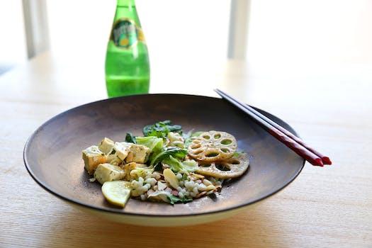 Shabu Shabu on Plate Beside Chopstick and Soda Bottle