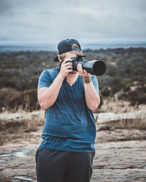 Photo of Man Taking Picture