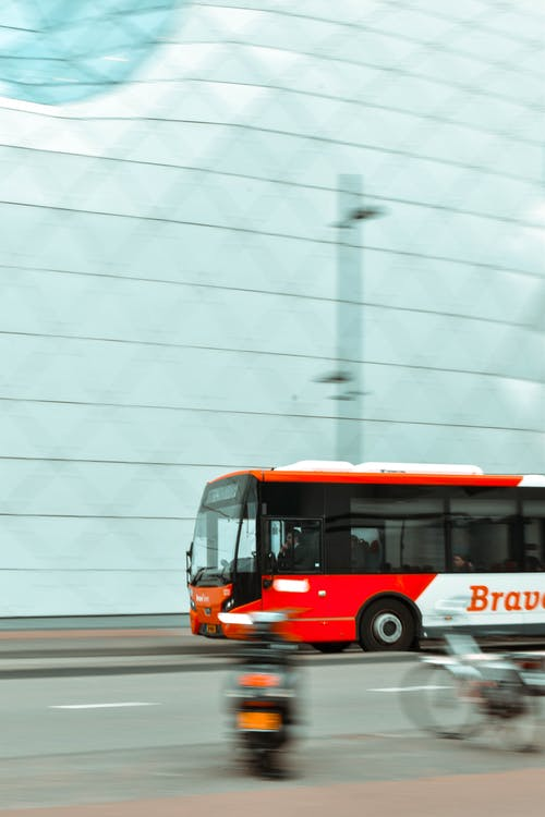 Selective Focus Photography of Red and White Bus