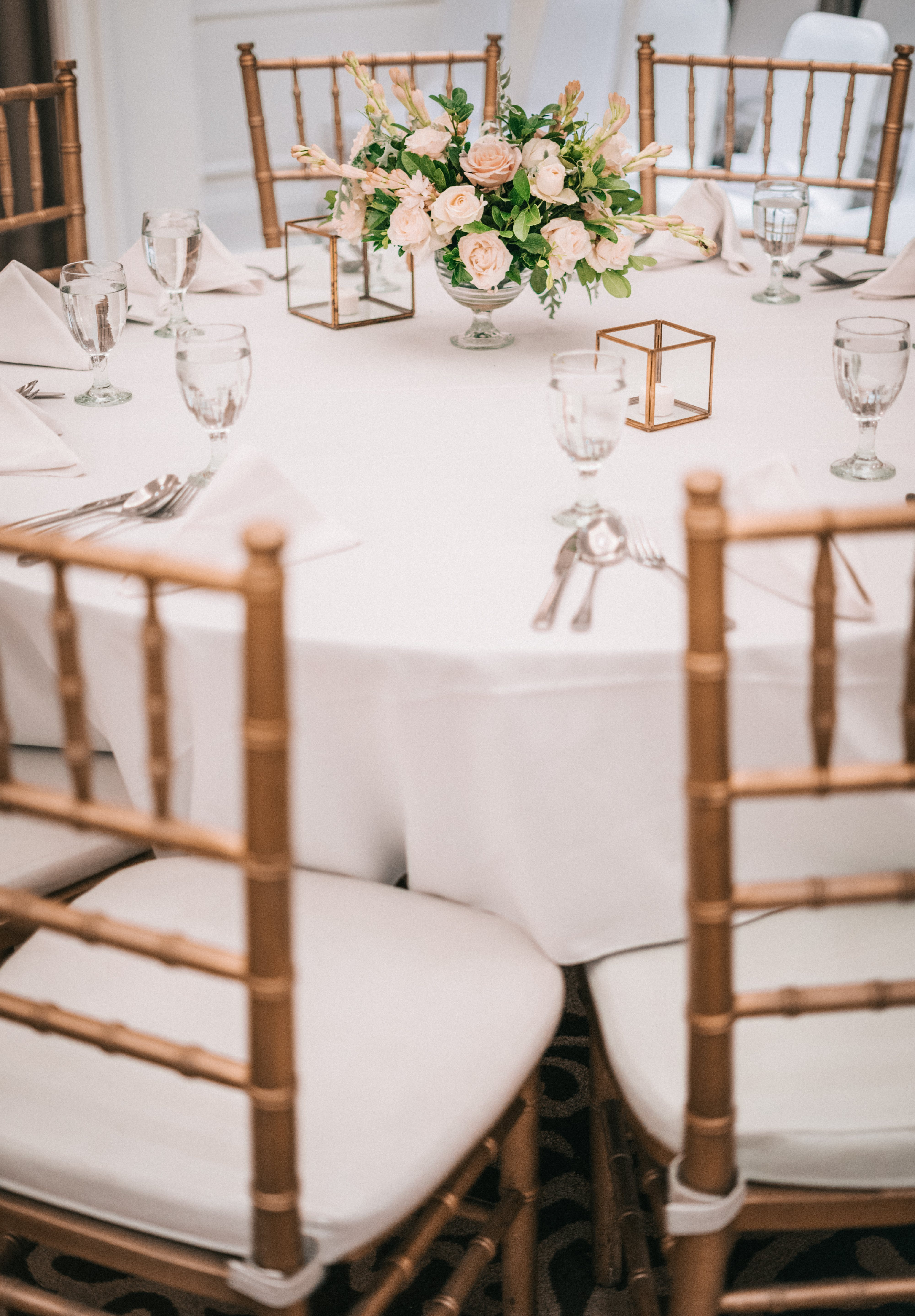Flower Arrangement on Top of Table With Chairs