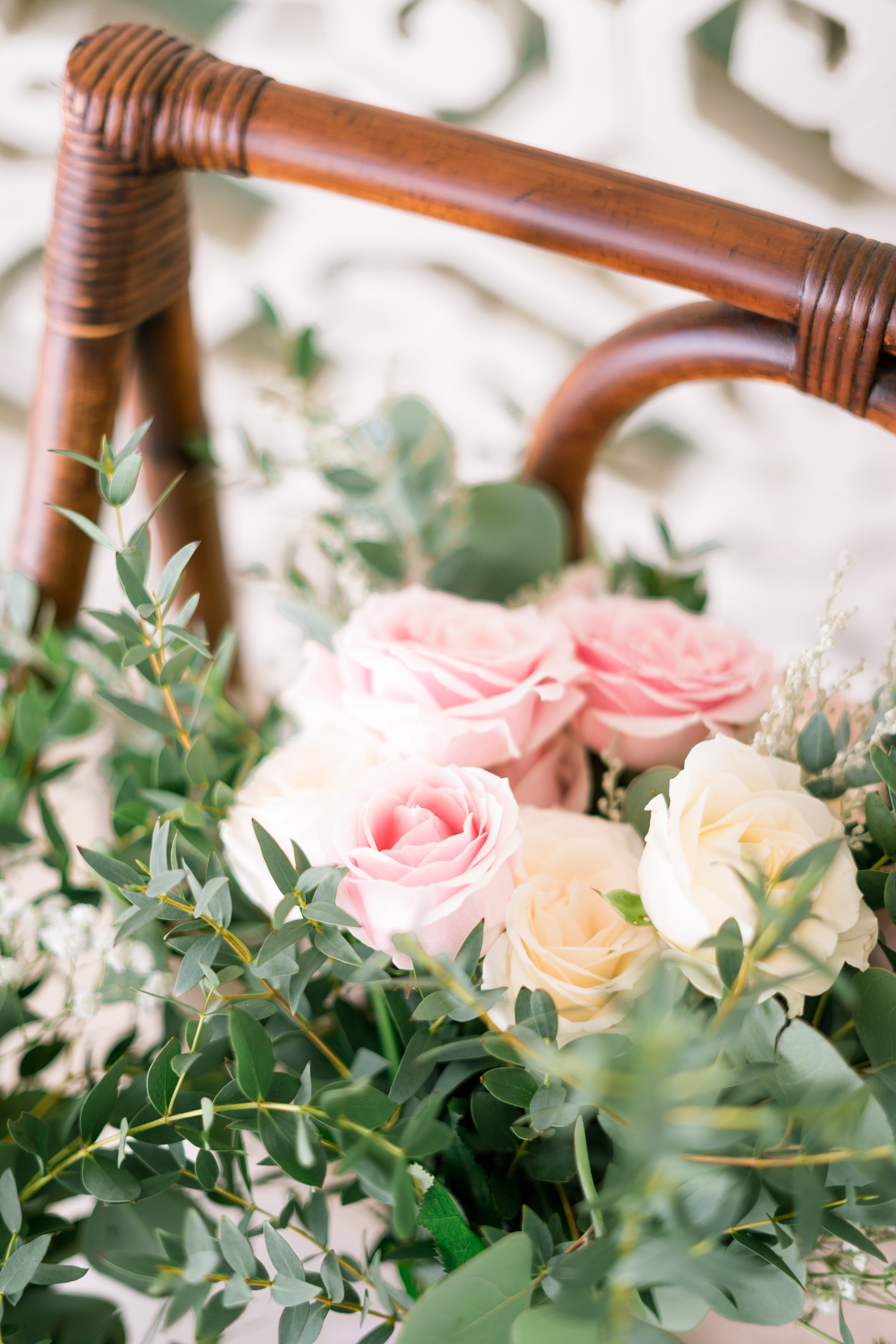 Selective Focus Photography of White-and-pink Rose Flowers in Basket