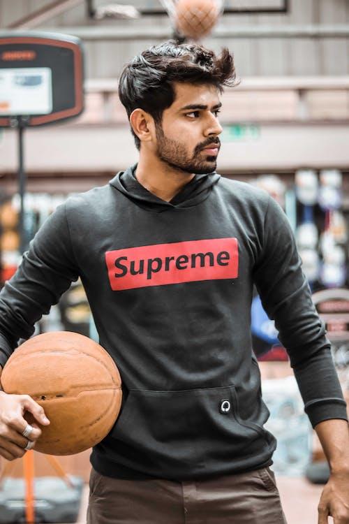 Man Holding Basketb