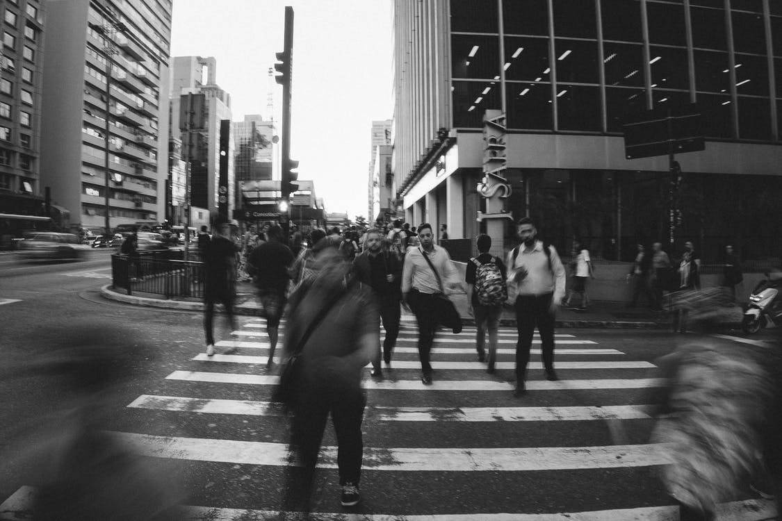 Grayscale Photo of Crossing The Road