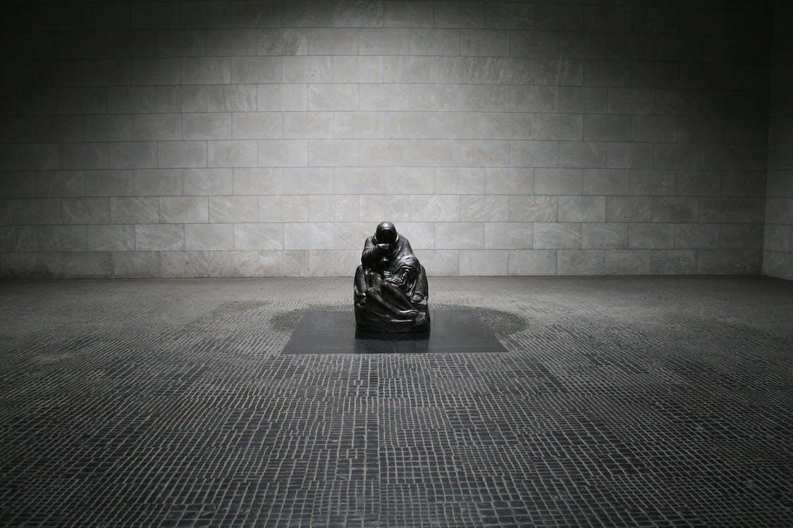 Man in Monk Suit Sitting
