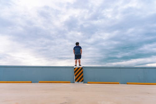 Free stock photo of 20-25 years old man, cloudy, cloudy sky, parking lot