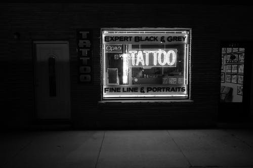 Grayscale Photo of Tattoo Neon Signage