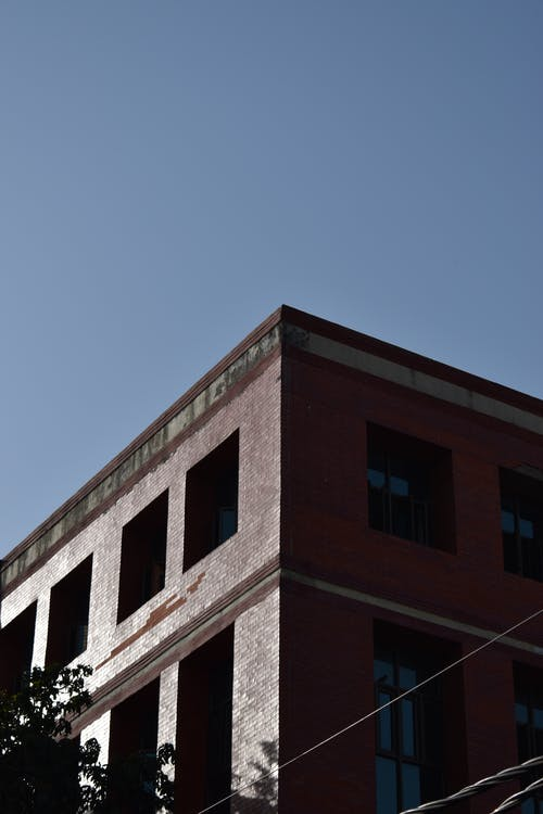 Free stock photo of apartment buildings, blue, blue skies, blue sky