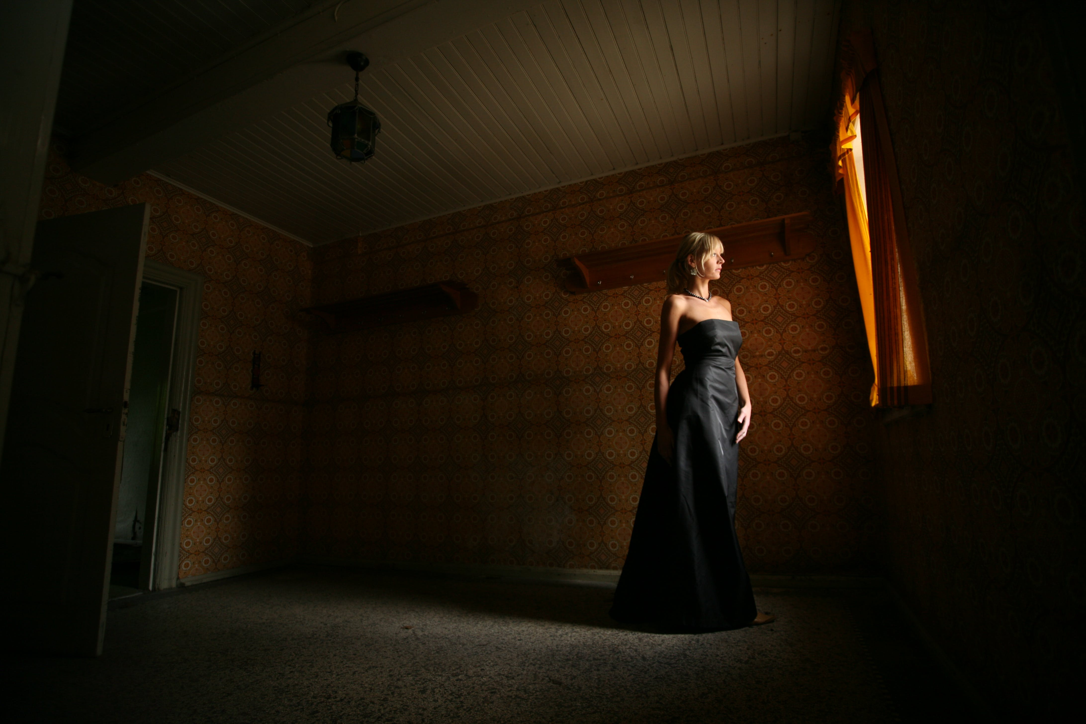 Photography of Woman in Black Dress in Room