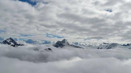 Immagine gratuita di inverno, montagne, nuvole