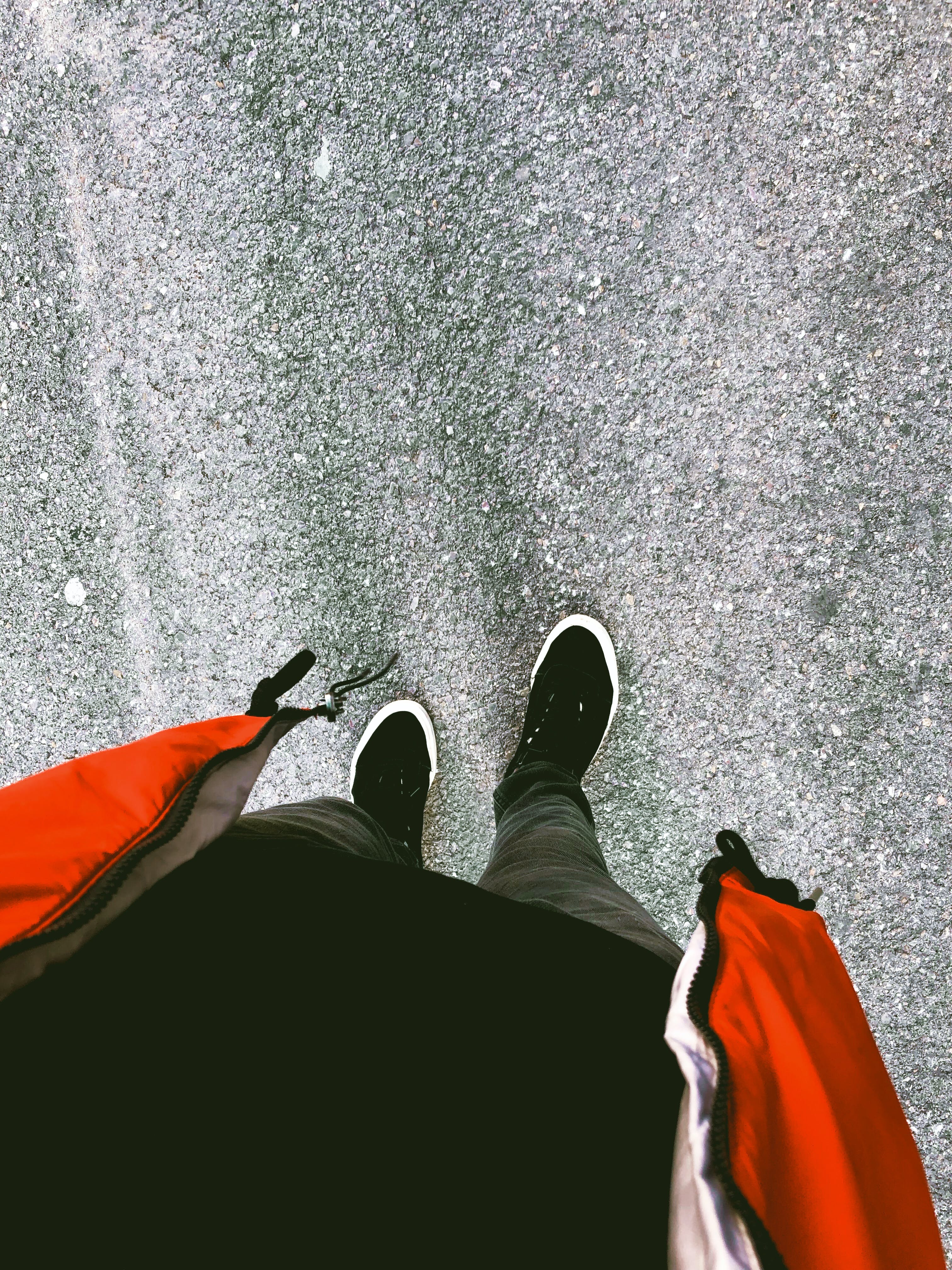 Person Wearing Pair of Sneakers