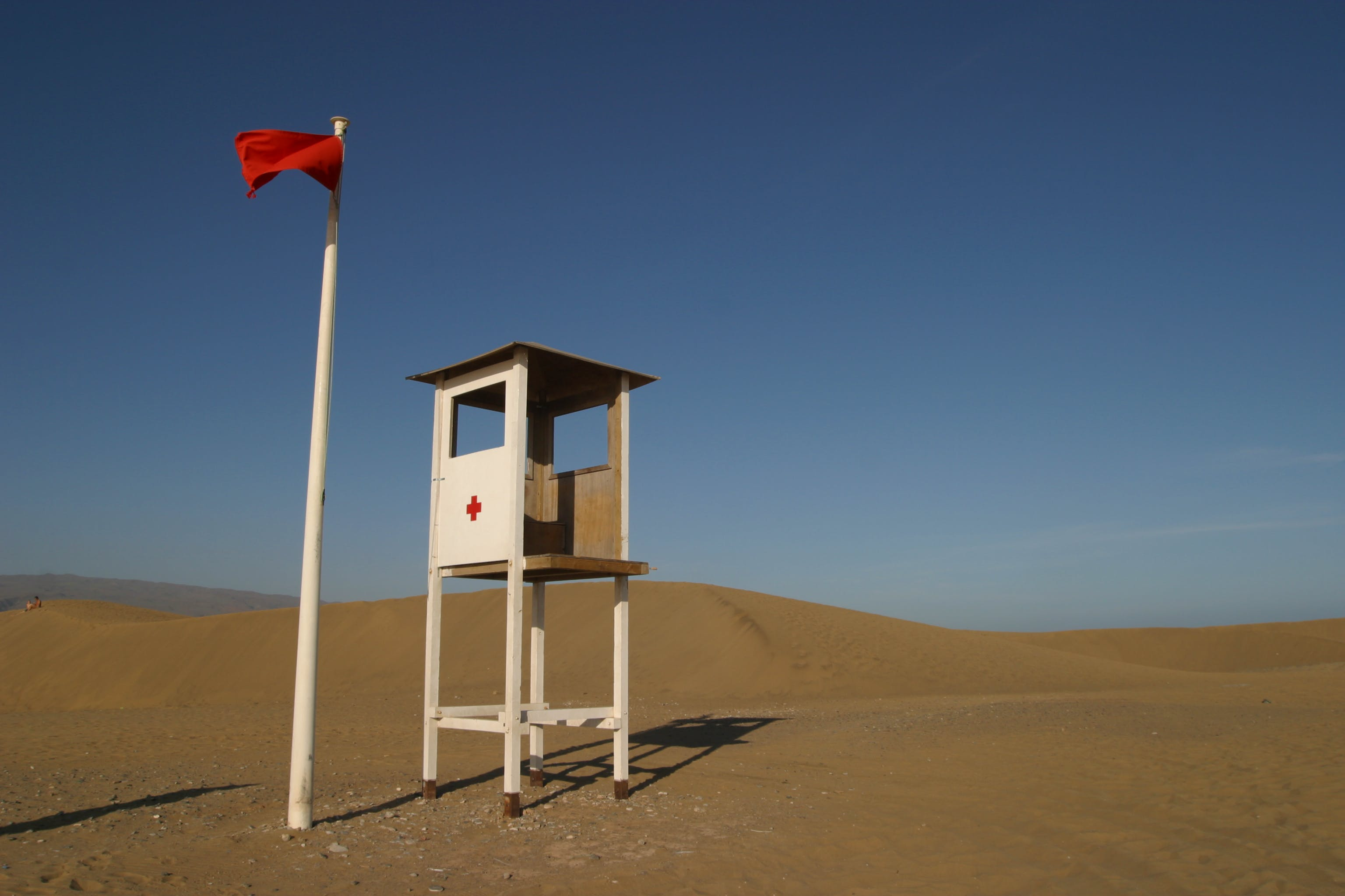 White Lifeguard House on Sand