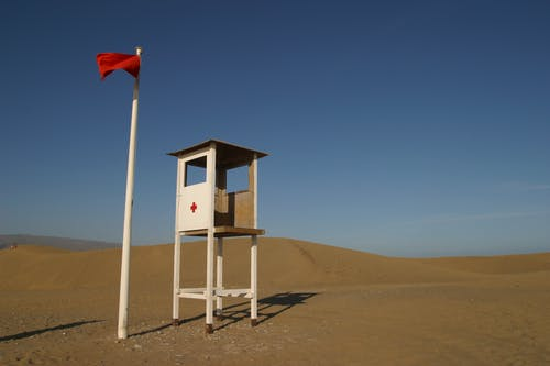 White Lifeguard House on Sand
