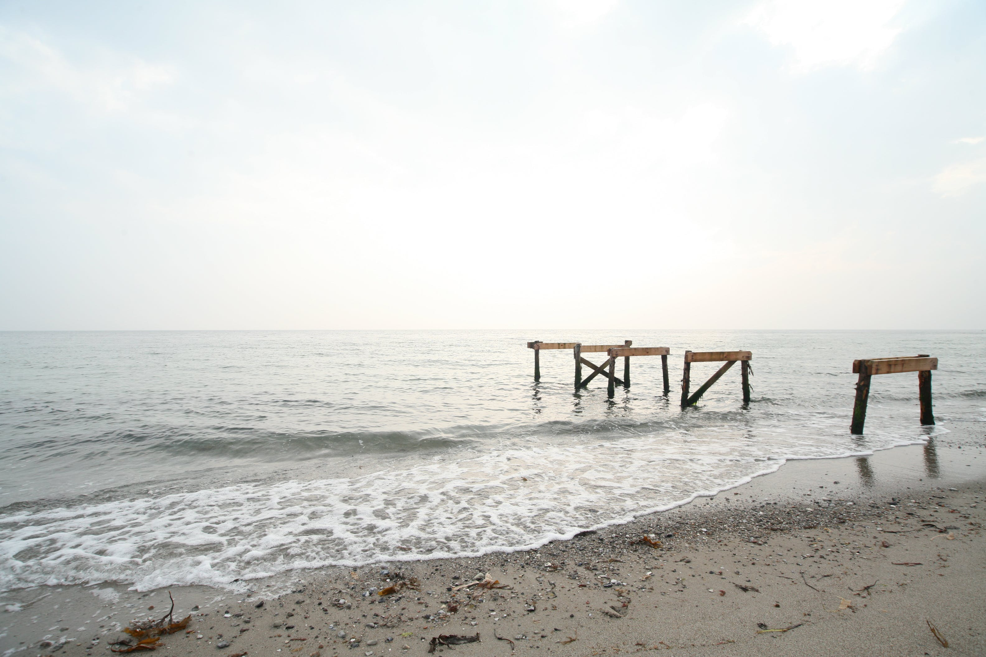 Brown Wooden Dock Frame on Sea Shore