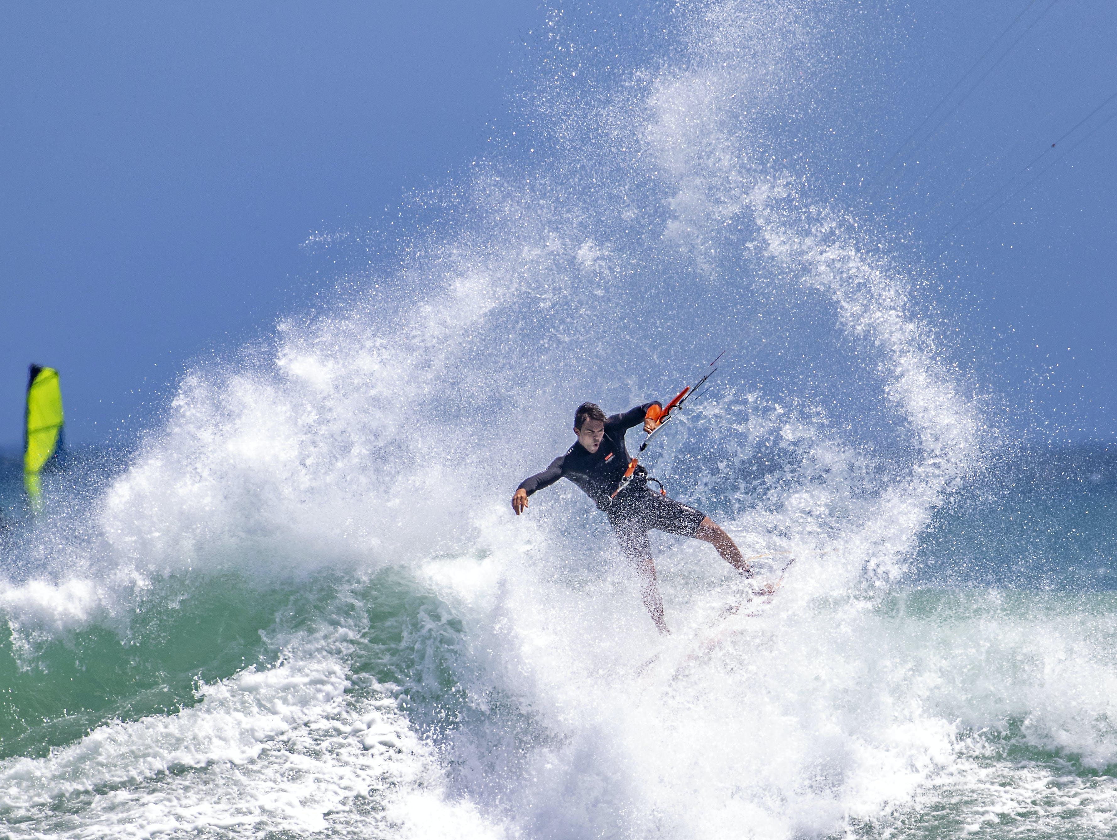 Man Water Skiing during Day