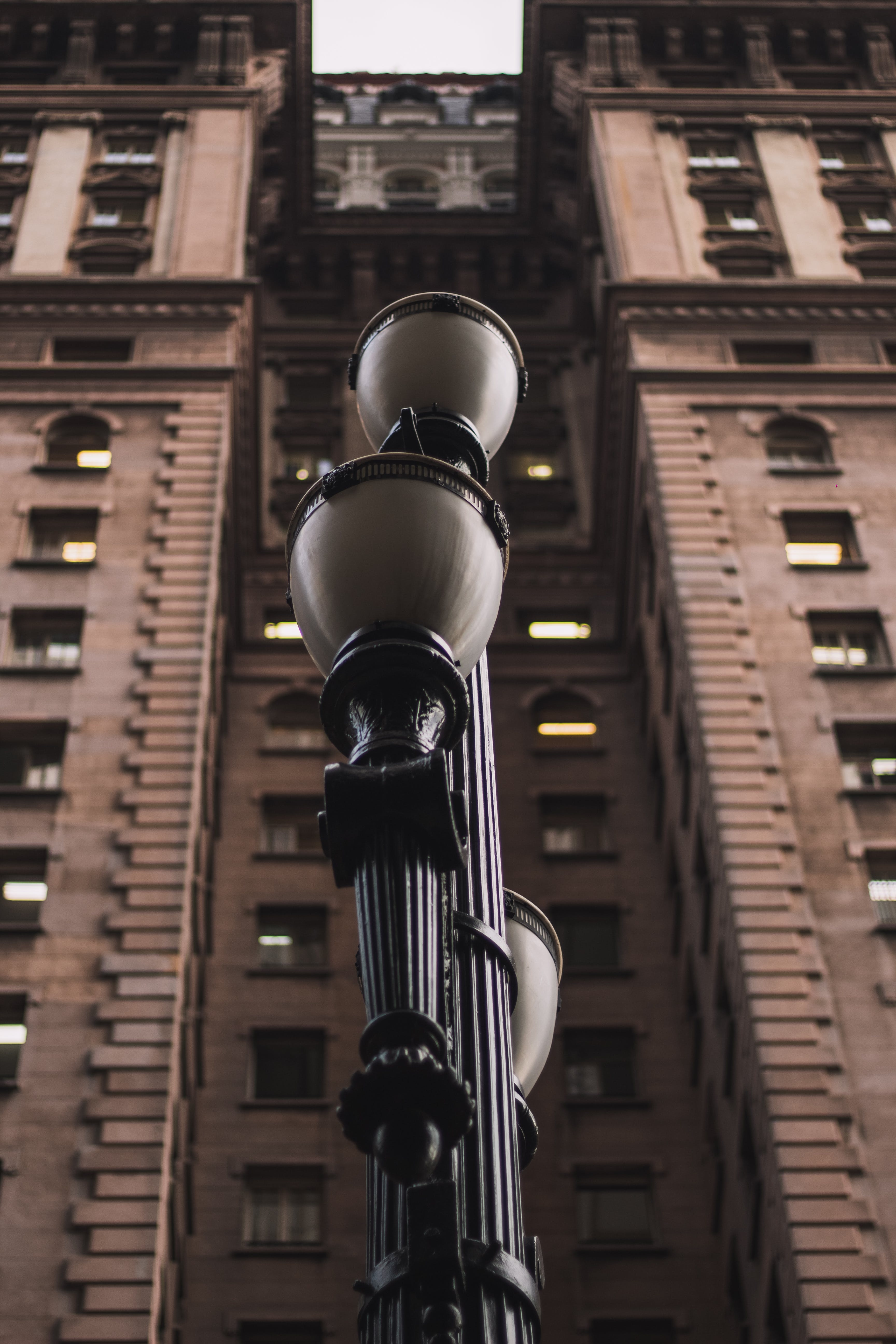 Black Light Post in Front of Brown Building