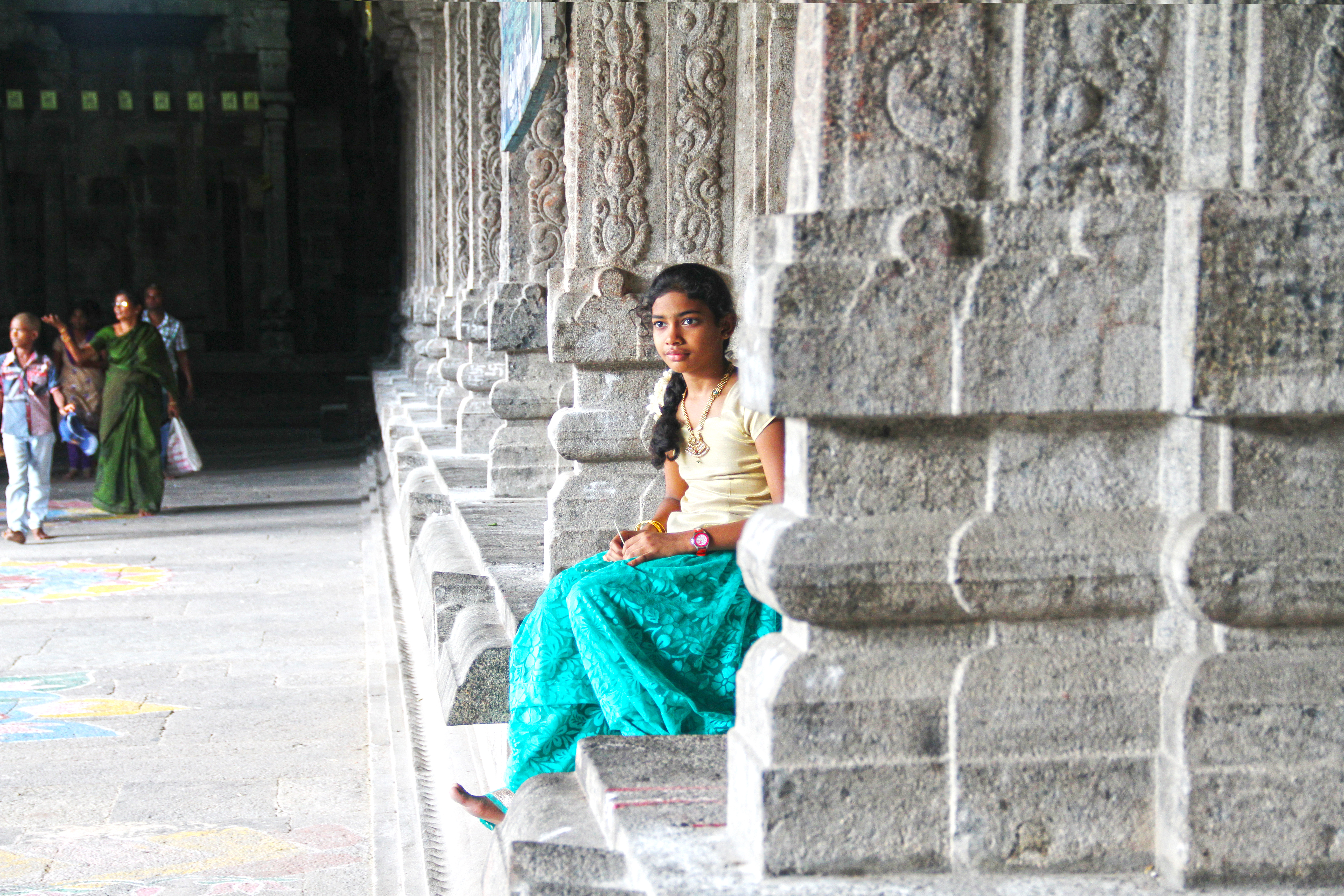 Girl Sitting Near Pillars