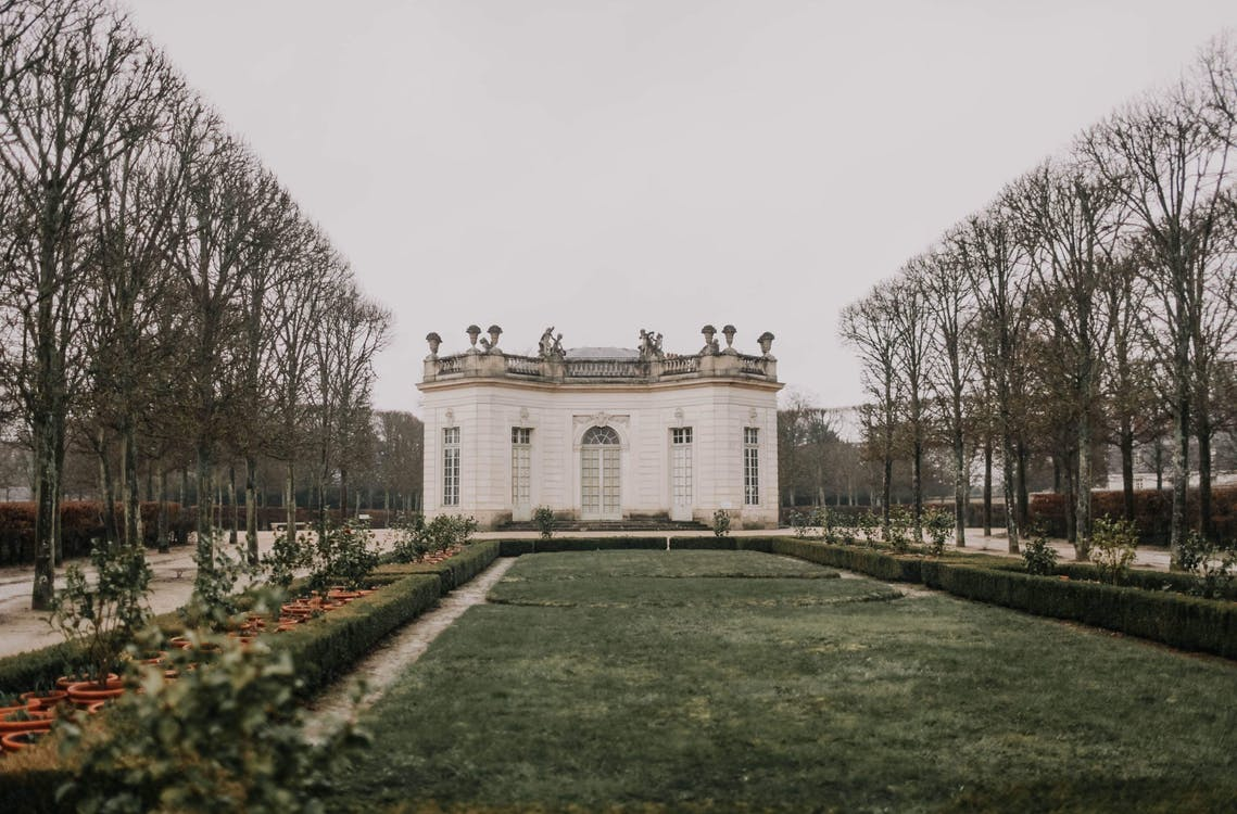 Majestic white palace with private park on overcast day