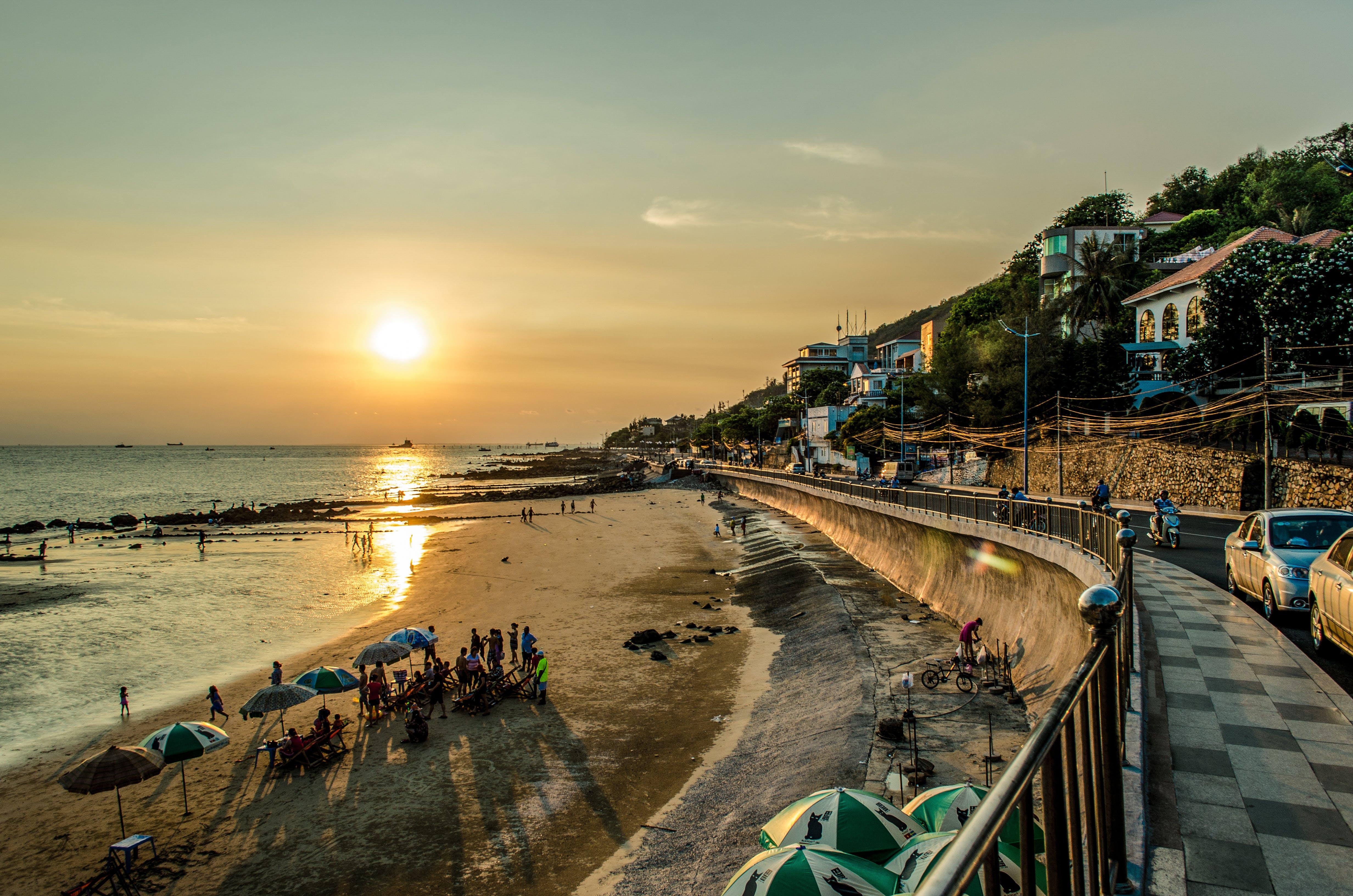 Fotos de stock gratuitas de ciudad, costero, dorado, mar