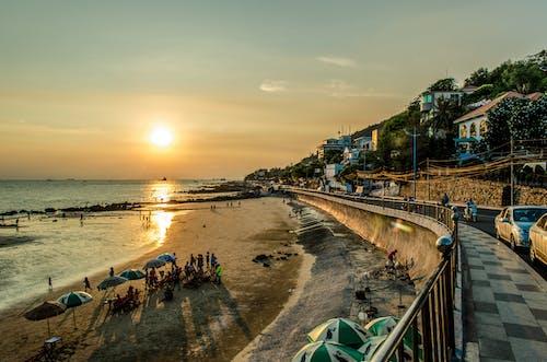 Photos gratuites de côtier, coucher de soleil, doré, mer
