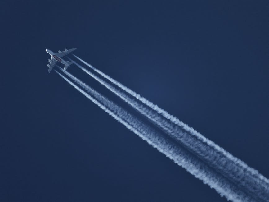 Flying Plane Leaving Contrails