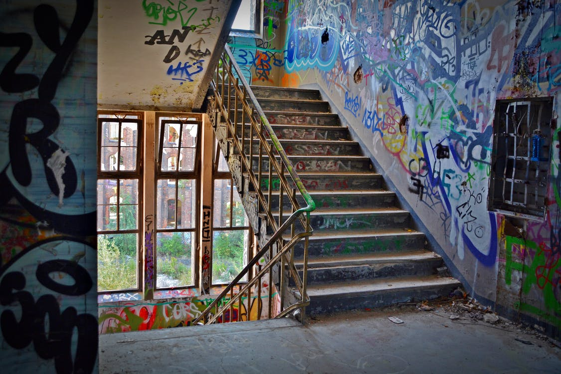 Graffiti Wall With Wrought Iron Donwstairs